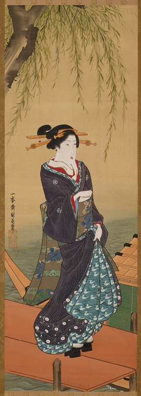 3/4 view of woman standing on a dock facing R, gathering skirts in PR hand; resting PL hand on bundle of papers tucked into front of obi; mouth partially open; willow tree branch frames scene at top; boat visible at LR; dark blue kimono with lighter blue duck motif trim