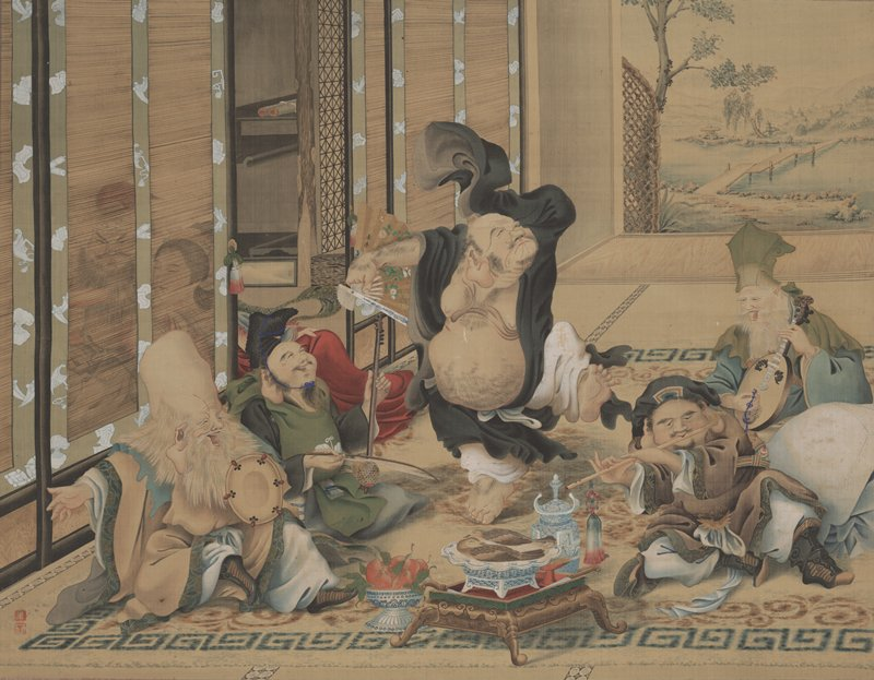 four men seated on either side of a wool rug playing various instruments; a fifth, larger man in black robes with an exposed, hairy belly dances in center of scene; bowl of fruit and tray with two birds in front center of scene; male and female figure visible in adjacent room through drawn blinds; the woman's body ties the two rooms together