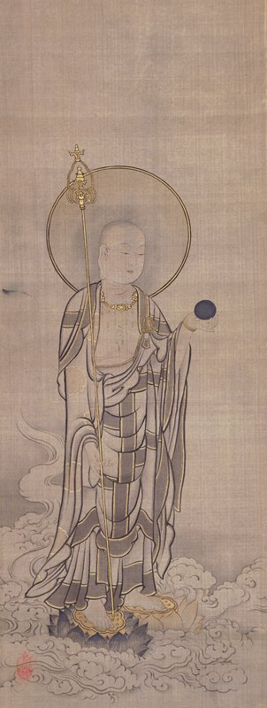 robed figure standing in center with large halo behind head, holding golden staff in PR hand and round black object in PL hand; figure stands on lotus riding on swirling clouds or waves
