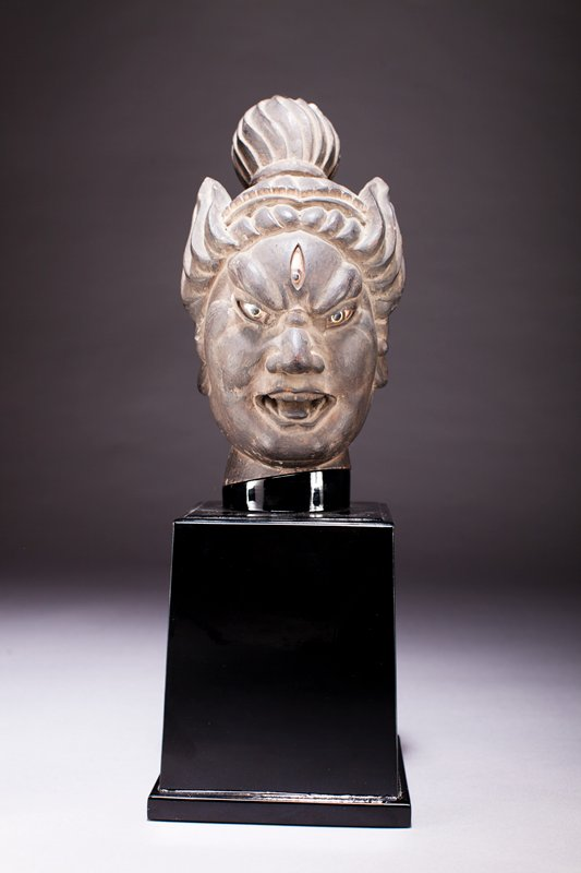 head of figure with open mouth, top knot, and third eye; all eyes inlaid crystal; shiny black base