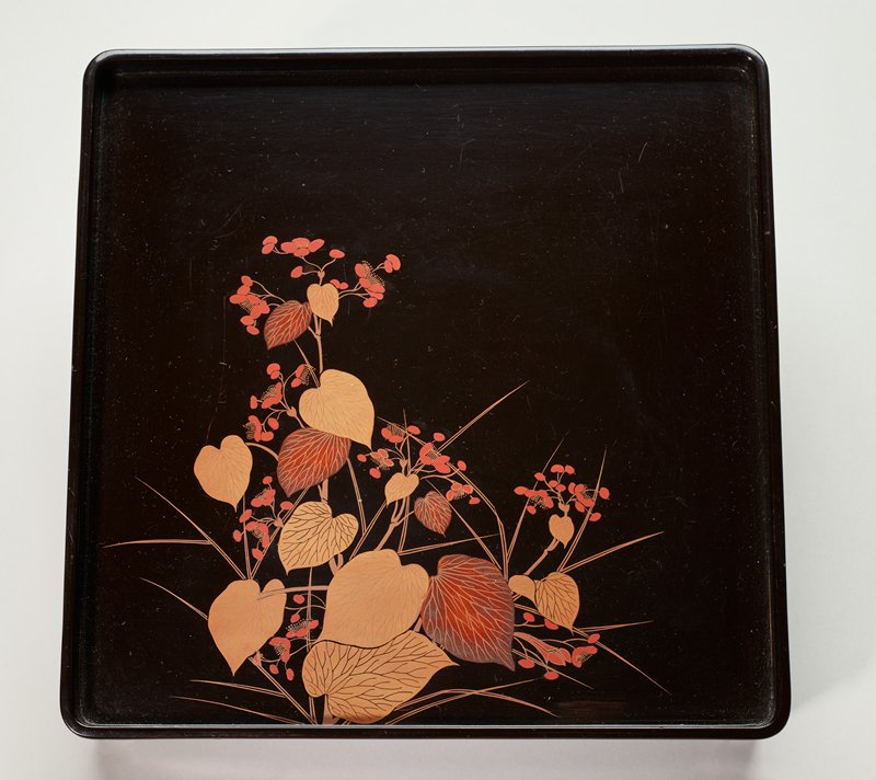 black lacquer tray with design of pink flowers with heart-shaped leaves