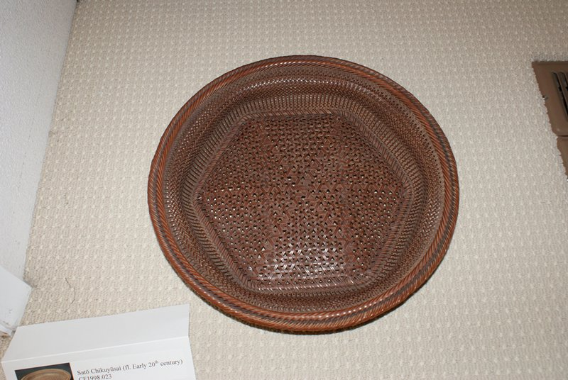 low, round basket with hexagonal base; double rungs around lip; three-dimensional, tiny openwork weave patterns; larger weave pattern bottom