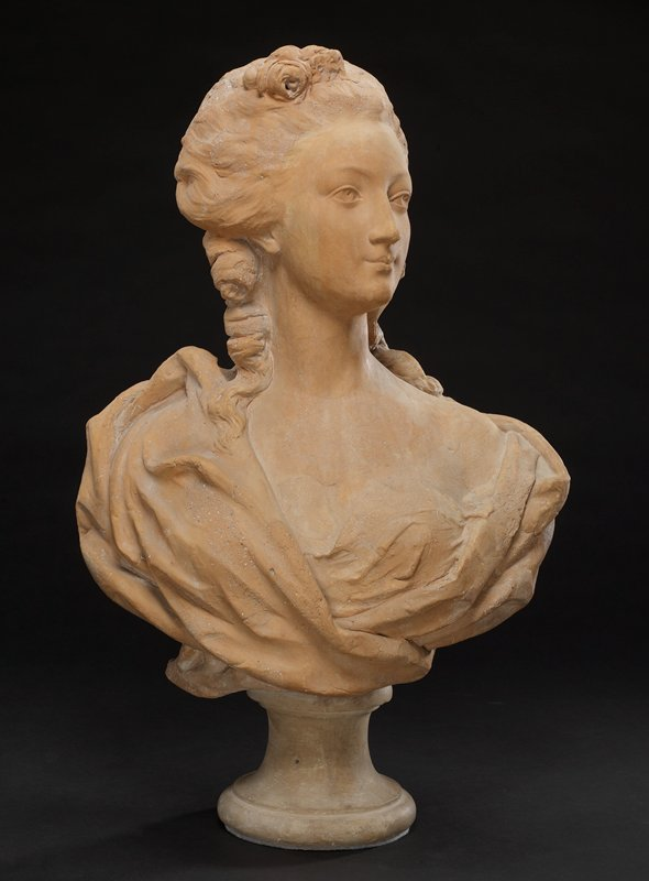 'Bust of a Woman', terracotta, French XVIIIc cat. card dims H 26 x W 16-1/2'. Female bust, gracefully draped with finely molded head turned half profile towards left shoulder. Hair dressed in curls with tiny flowers.