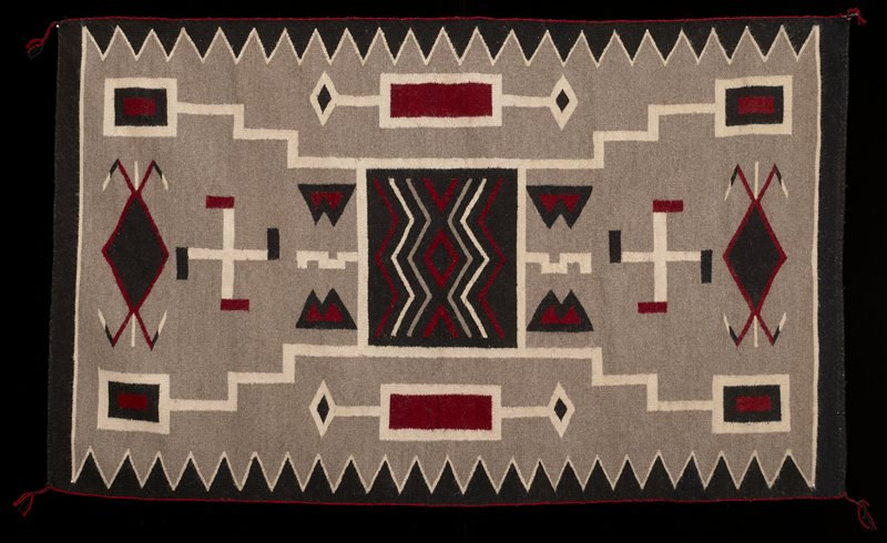 black, cream, red and grey; geometric patterns with square at center with zigzags, diamond and chevrons; zigzags on two long sides