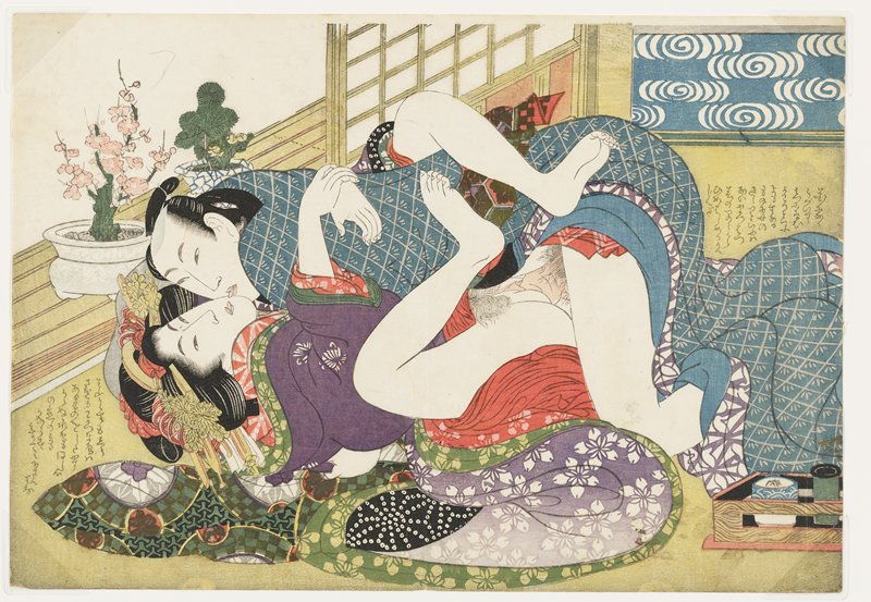 couple engaged in intercourse, enveloped in brightly-patterned fabrics; man's kimono is blue with grey checked pattern with stylized leaves; woman's outer kimono is purple with white flowers; two plants at left--one with pink blossoms, the other similar to a small pine; text in LLC and at right edge, URC