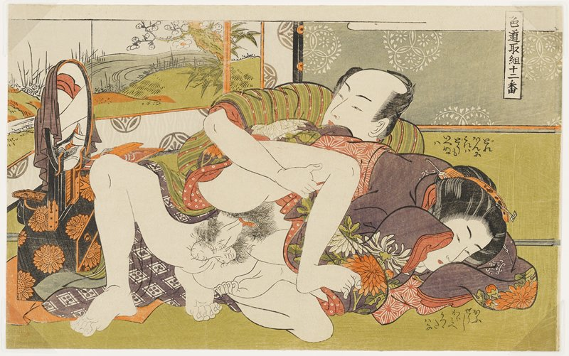 couple engaged in intercourse; woman wears a purple kimono with white and orange flowers; man wears a green, orange and white striped kimono; man looks in an oval mirror on a black lacquer vanity stand with orange flowers at left; text above and below woman's head