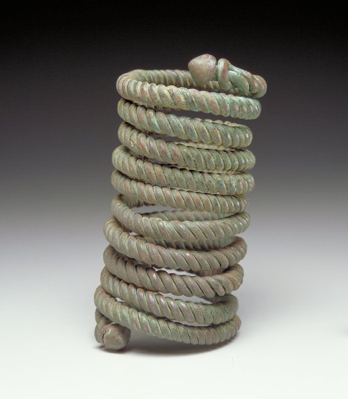 metal spring of coiled copper wires; ends of coils are cone shaped
