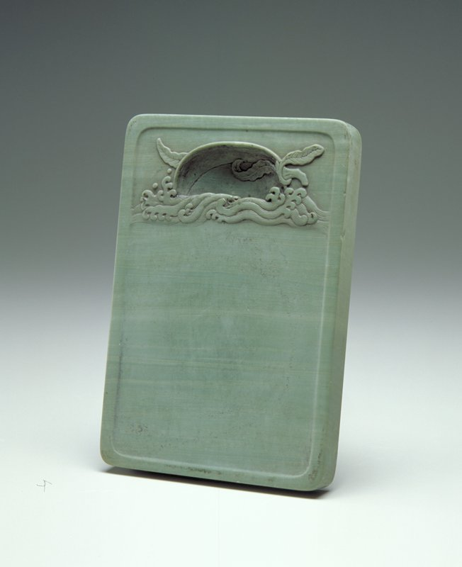 green stone; rectangular with rounded edges; sunken water pool and relief design of peach with 3 leaves on waves on front; inscription and 2 imperial seals on back
