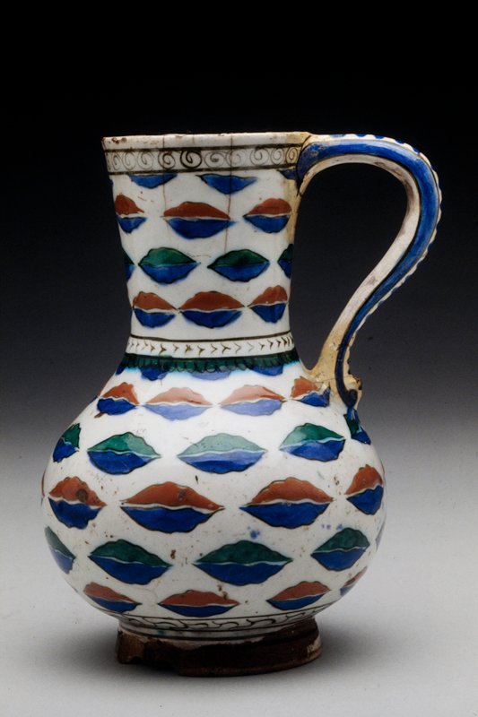 Pitcher white ground with cloud band decoration in tomato red, green and blue; so called Rhodian ware (Iznik ware)