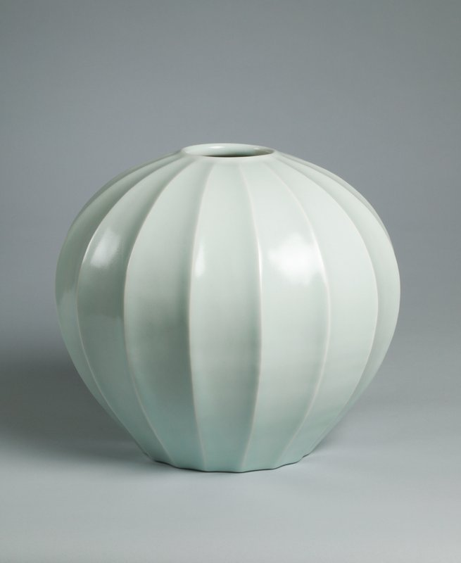 round vase with scalloped facets; small round, slightly raised mouth; pale celadon glaze