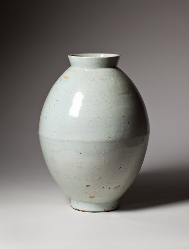 oblong porcelain jar with rounded body; slightly flaring mouth; smaller, rounded foot; pale greenish-blue glaze