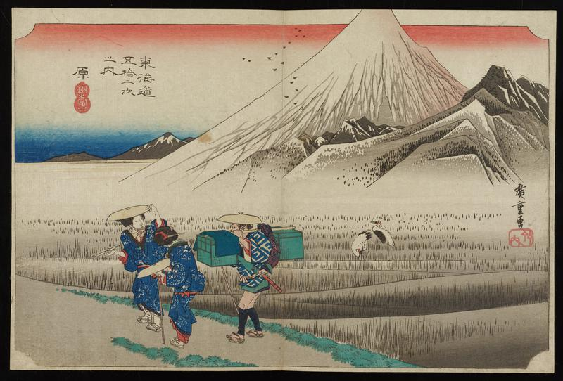 Mt. Fuji in background; grayish rice fields with two cranes in middle ground; three travelers standing in a group at L, one carrying a large parcel