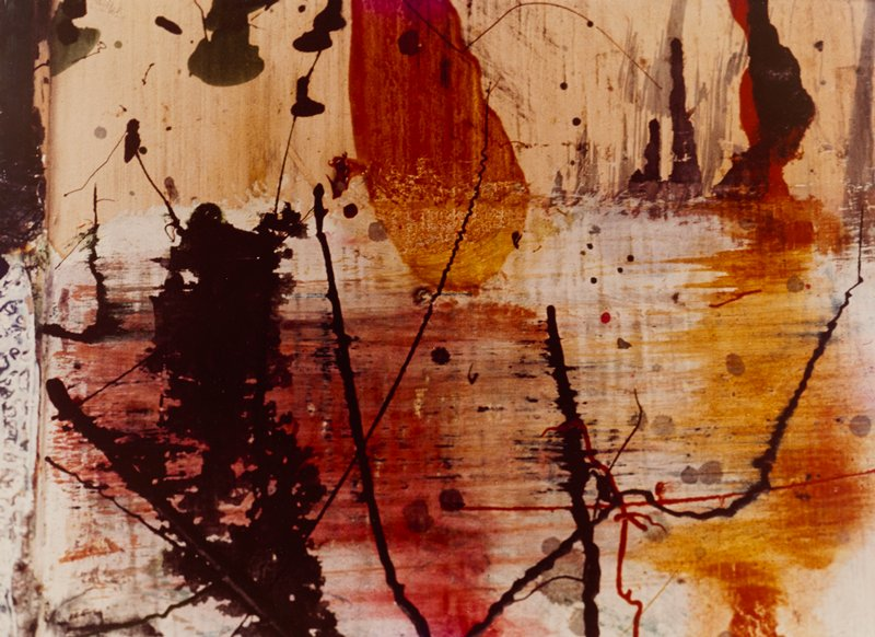 detail or painted wall: red/orange band across C of image with splatter painted black and red lines; black inky blotch at R; red form lower C