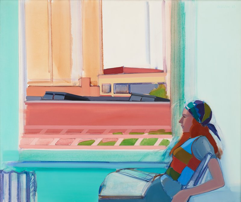 seated woman in profile from PL in LRQ, with long reddish brown hair wearing a blue, purple and green scarf on her head and a short sleeves blouse with blue, olive, green and rust blocks of color; radiator, LLC; large window with view of blocky, simplified buildings in shades of pink, green, dark red, blue, grey and tan; blue-green walls