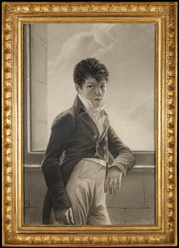 black and white of portrait of a young man standing in front of an open window; PL arm rests on ledge; wears buttoned up coat, high waist pants neck scarf with upturned collar; faint clouds in sky through window