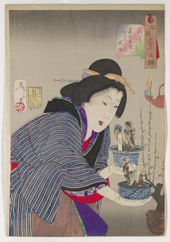 woman holding a blue and white spot of small plants in each hand, bending slightly forward; woman wears brown, white and blue striped kimono with black trim; branches with white floral blooms in URQ, with burning lamp at right center