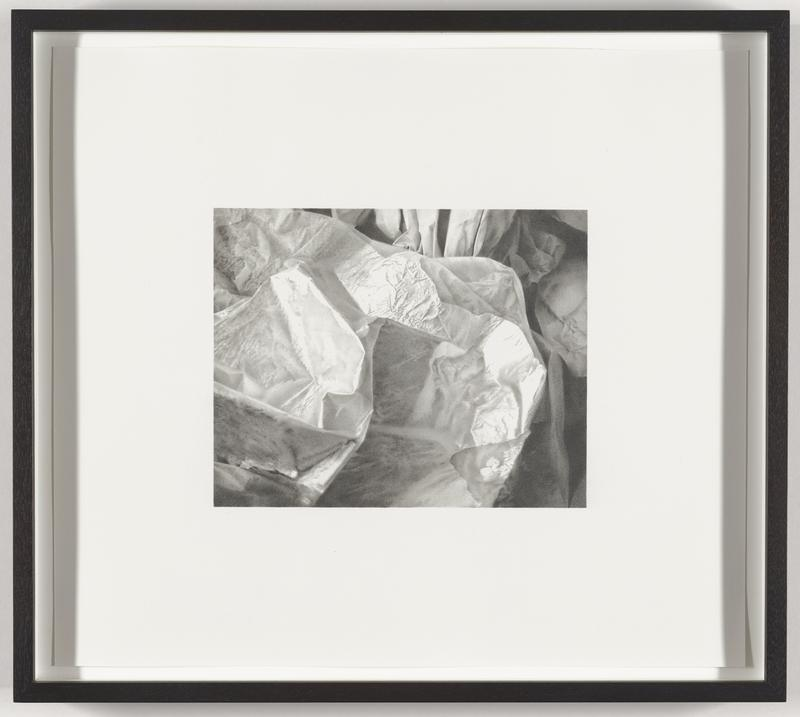 hyper-realistic black-and-white image of folded or creased and crumpled paper and/or cloth; triangular shaped element at top center