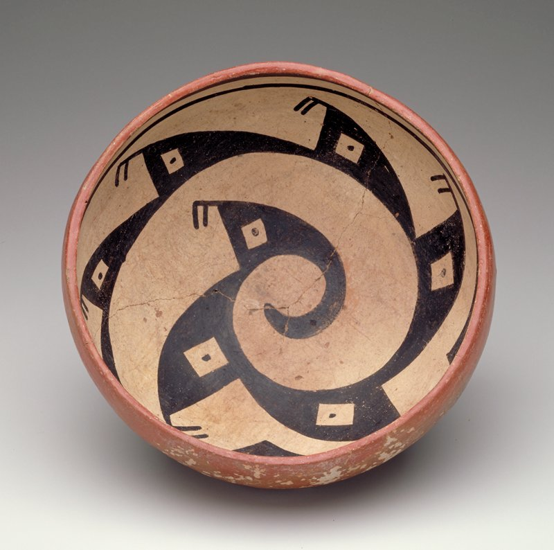 bowl with rounded bottom; red on exterior; interior decorated with a black spiraling figure with geometric designs on a white ground