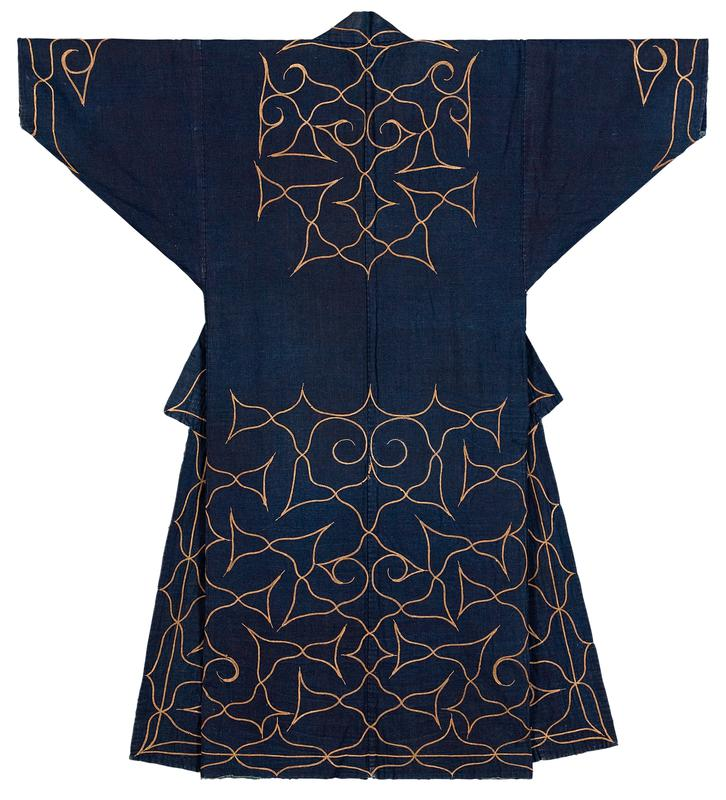 navy blue robe with organic taupe colored embroidery over sleeve cuffs, chest, yoke, and lower half; embroidery pattern is organically flowing with swirls and points