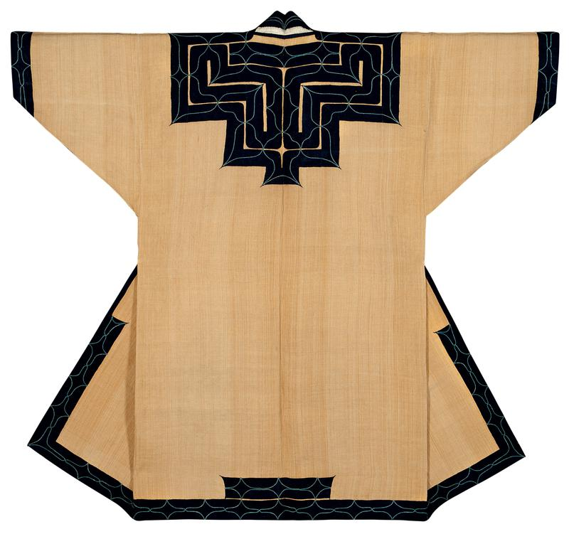 light brown robe with navy blue applique trim around sleeve cuffs, bottom hem, center edges and upper back; light blue applique is attached on either side of the navy blue yoke applique; blue swooping embroidery throughout; light blue lining on interior bottom and at chest