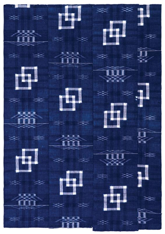 four vertical panels of blue fabric with white pattern sewn together; pairs of white squares and crossed diamonds alternate in pattern throughout; strip of black Velcro (loop) along top edge on verso