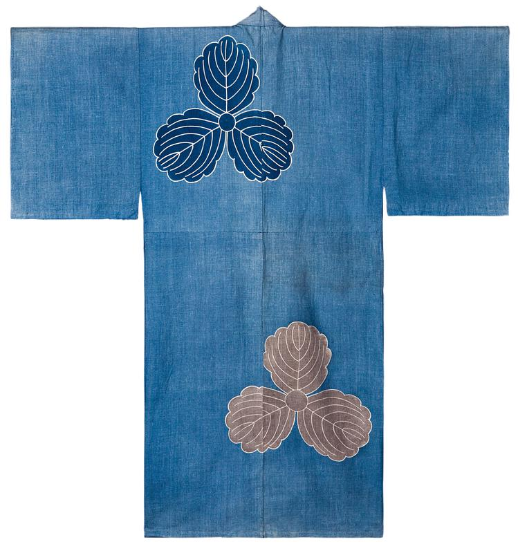 pale blue kimono with blue floral element at top center on back as well as on front PL side at bottom; pale gray floral element at bottom PL