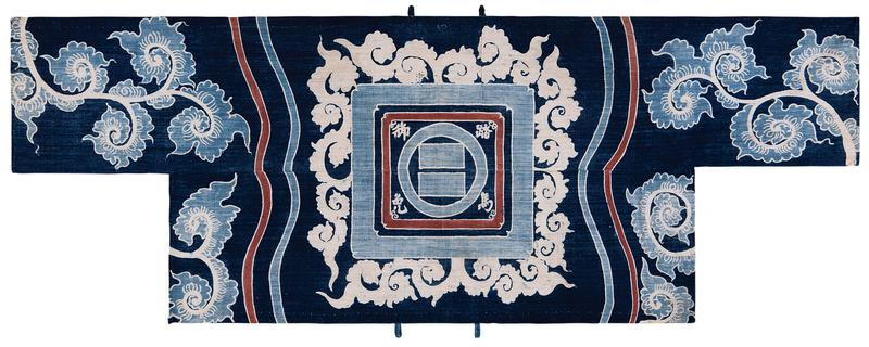 blue T-shaped cover with white, light blue, and brown designs (two panels of different widths); curling, white tendrils, light blue square, and brown square at center, framing a light blue circle and white Japanese characters; light blue and white curling floral designs on either side; four small fabric loops, two at TC and two at BC; a blue knotted thread loop attached at both LLC and LRC