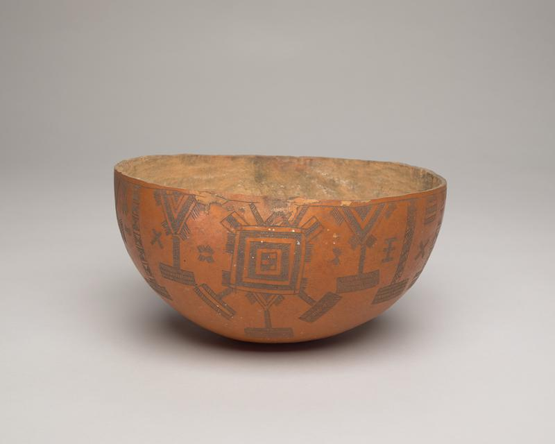 bowl with rounded bottom made from a gourd; orange exterior with incised intricate designs with squares, diamonds, and bars with diagonal lines; tan interior