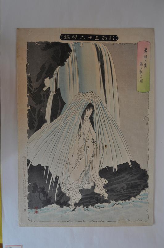 woman seated beneath a waterfall
