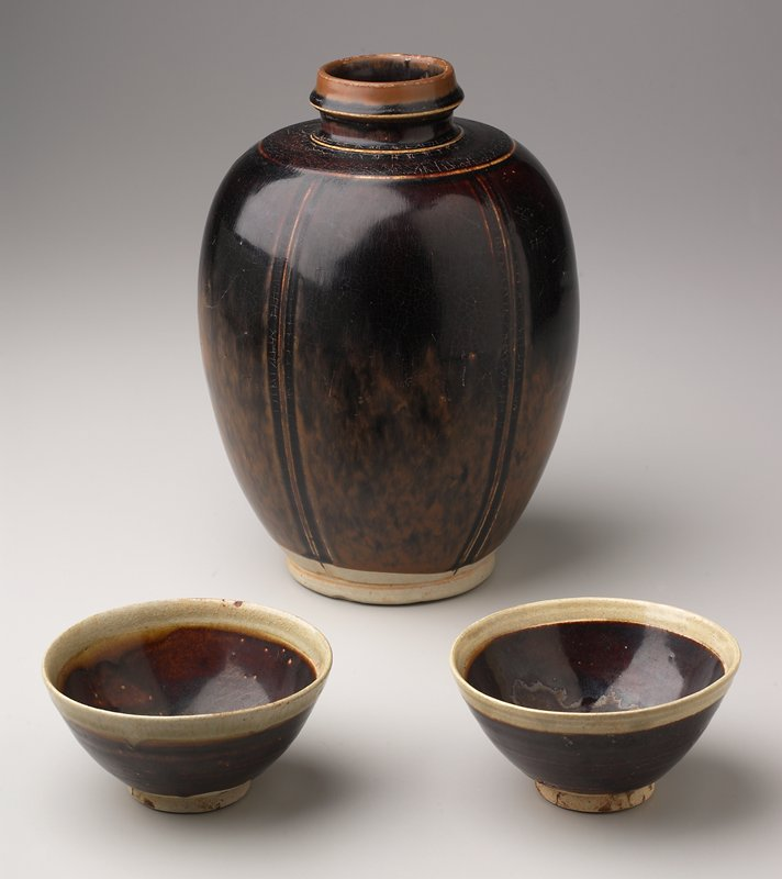 dark red glaze with band of green glaze at mouth rim; unglazed foot