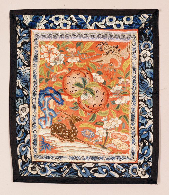 Panel aproicot satin ground elaborately embroidered with animals and flowers and fruit, some of which are worked in Pekin knots.