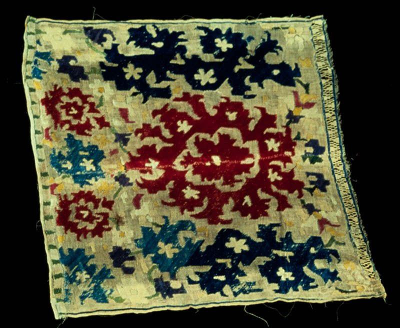 Cushion cover, square, embroidered mostly in red and blue on natural colored linen; strip of drawnwork outlined in blue across one side