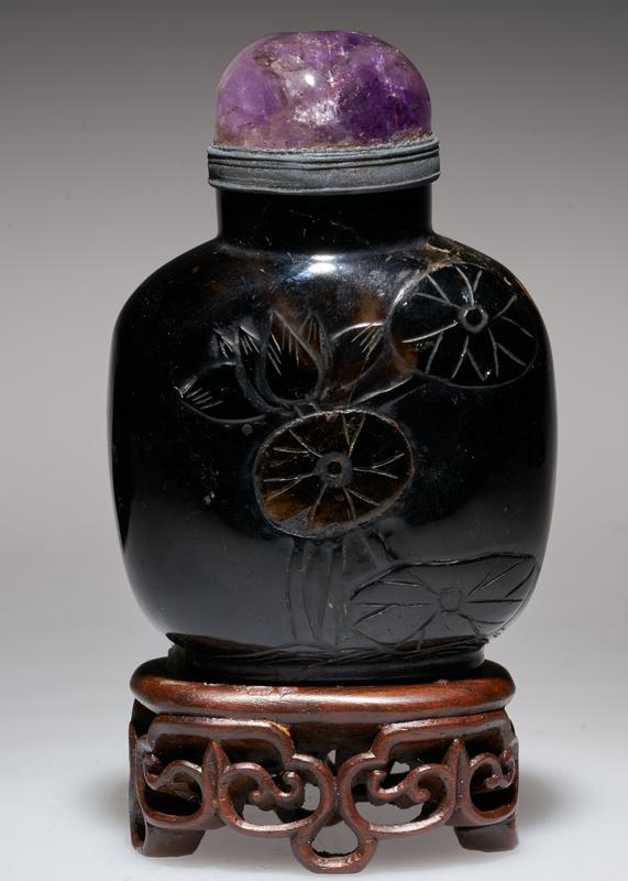 Snuff bottle. Smoky topaz. Amethyst top. Carved lotus and bambo design. Black crystal.