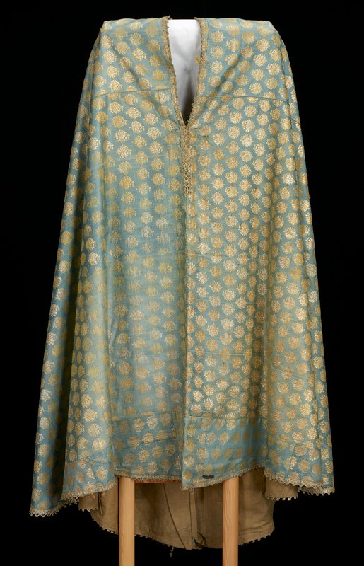 Priest's vestment; light blue and gold brocaded cape edged with gold braid, gold cross made of braid in center back.