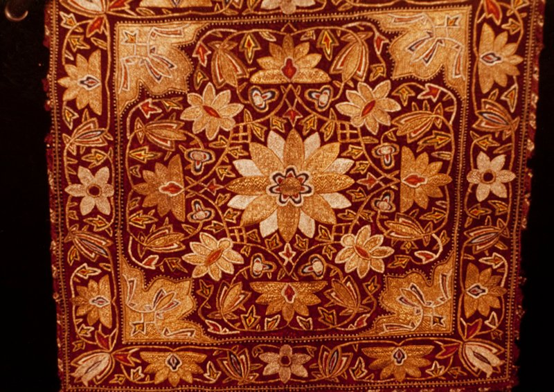 Cushion cover; red velvet embroidered in gold and silver in heavy floral motive. Velvet.