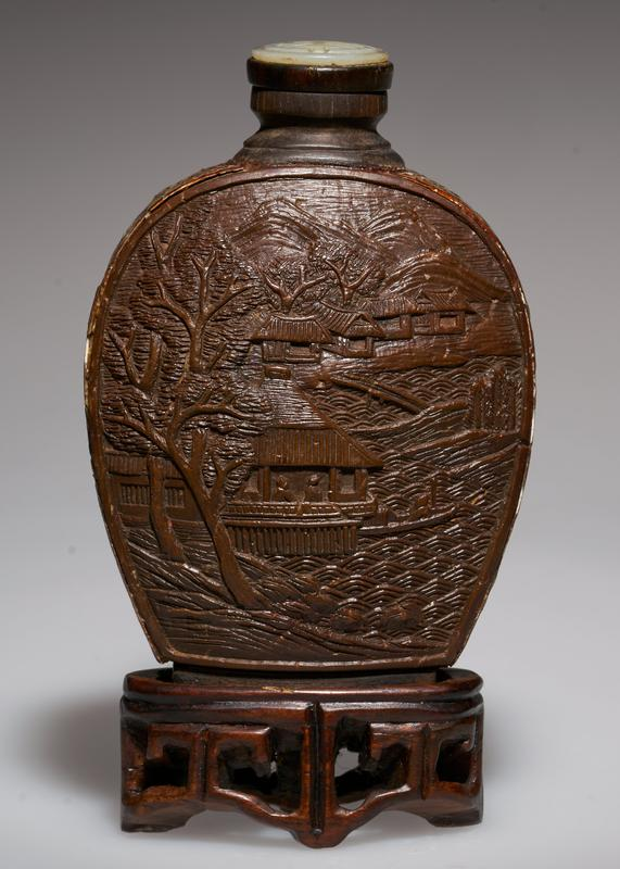 mother-of-pearl top; horn panels carved with landscapes; sides of bottle inlaid with mother-of-pearl