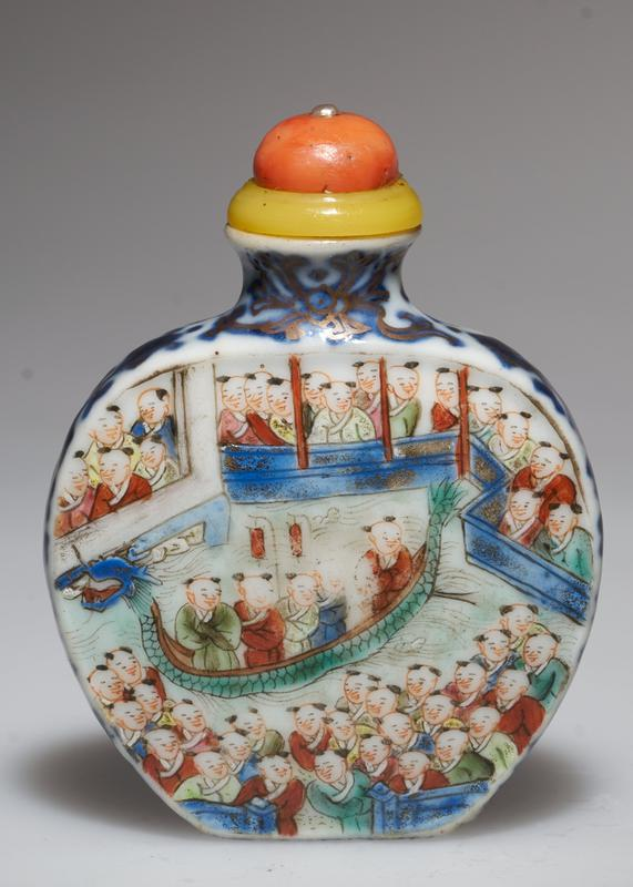 Snuff bottle. Porcelain, carved. Pink coral top. Celebrating a Buddhist festival. The 'Dragon Boat'. Mark on the bottom.