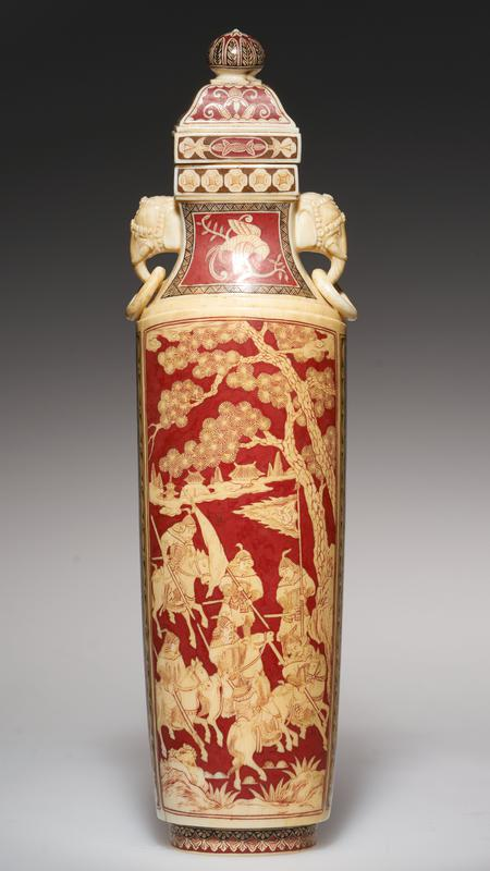 pair of covered ivory bottles, inlaid with red lacquer; heads of elephants forming handles; wooden standards
