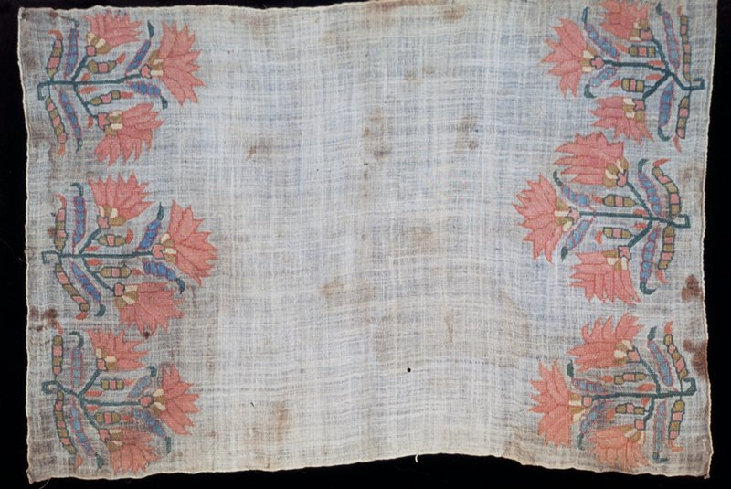 Towel of rather coarse linen with border at both ends embroidered with colored silks. Three floral sprays having three pink blosooms each form the border. Both ends are hemmed and sides finished with selvage. Linen, silk embroidery.