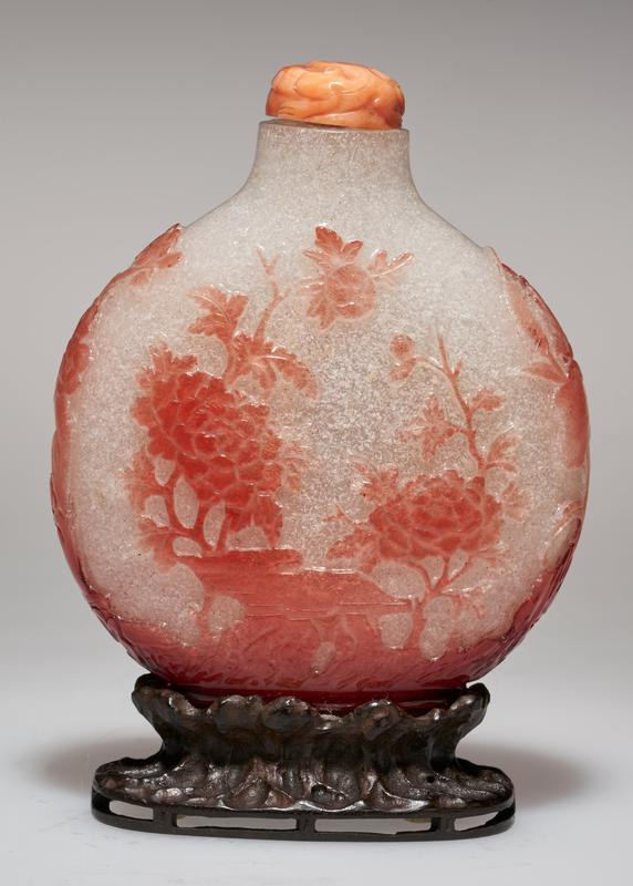 white glass, with overlaid carved coral color glass decoration; carved coral stopper; stand
