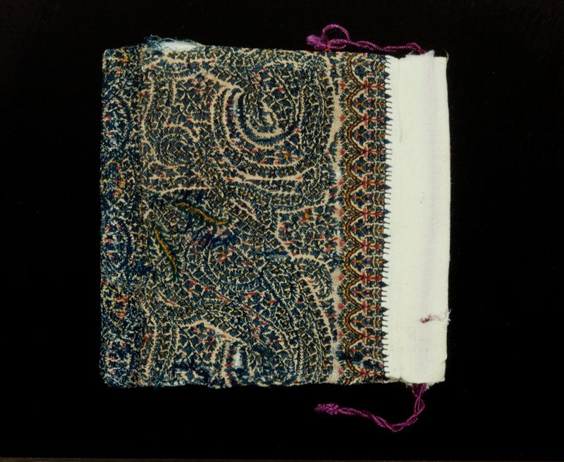 bag, piece of a Kashmir shawl with design of blue palmettes made up of tiny leaves and flowers; white wool lining