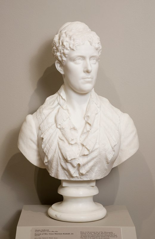Formal portrait bust of a middle-aged woman, solemn facial expression, wearing a ruffled collar made of printed fabric, no jewelry.