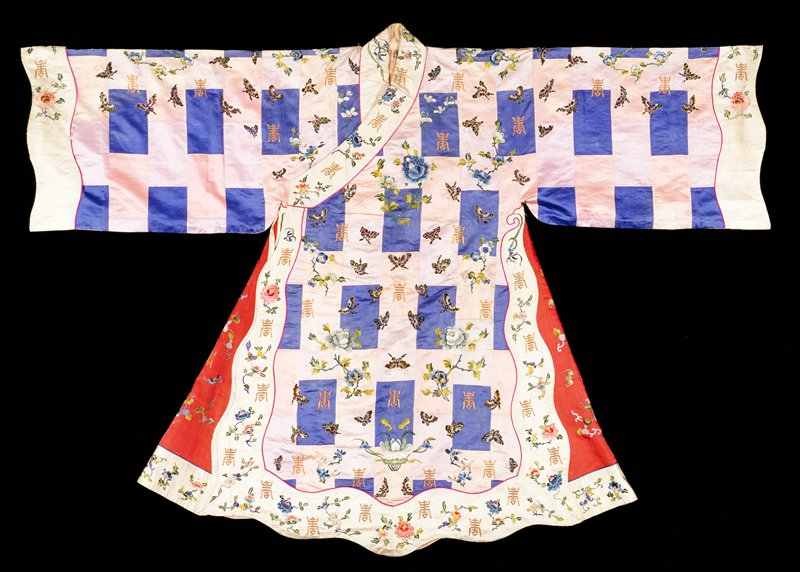 Actor's robe, imitating a priest robe, made up of pieces of satin in shades of blue, pink, and pale lavendar, and embroidered with butterflies, flower sprays, and good luck characters in gold and colored silk threads. Cuffs and shaped border of white satin embroidered with similar designs at sides; an inner border of red satin embroidered with bats, good luck characters and Taoist symbols. In center back a shaped medallion containing the appliqued figure of a god surrounded by floral sprays. Satin, stem, laid, and outline stitch. Lining of coarse pink cotton. Inscription in center back (lining).