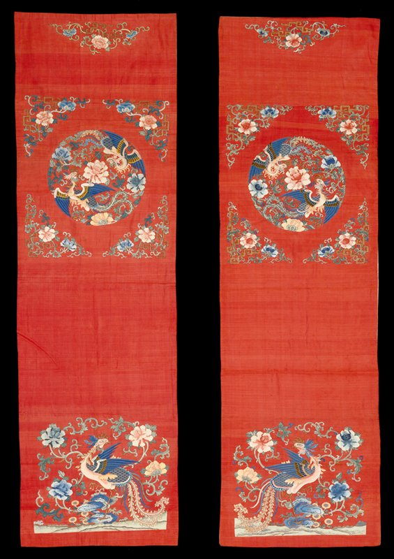 Pair of chair covers of rose-red k'ossu with a design of peony sprays and phoenix medallions in shades of blue, pink, green, yellow, gold and olive-green woven with gold threads. Some painted details. Lining of coarse pink cotton.