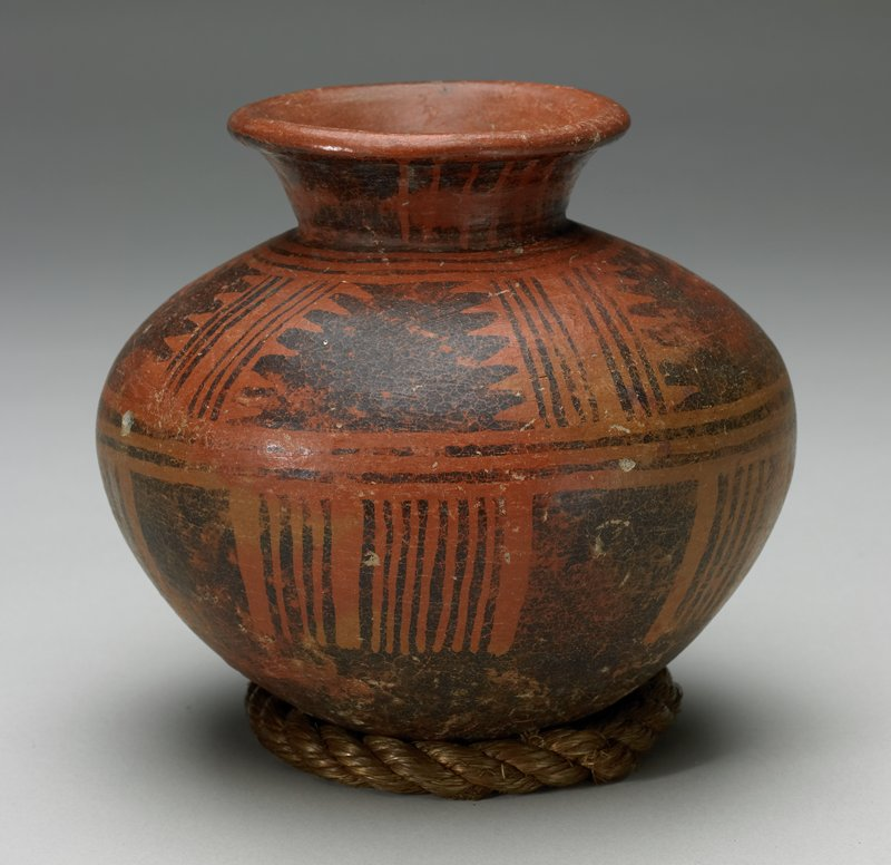 Jar with two bands of designs in black on red. The so-called 'lost color' ware.