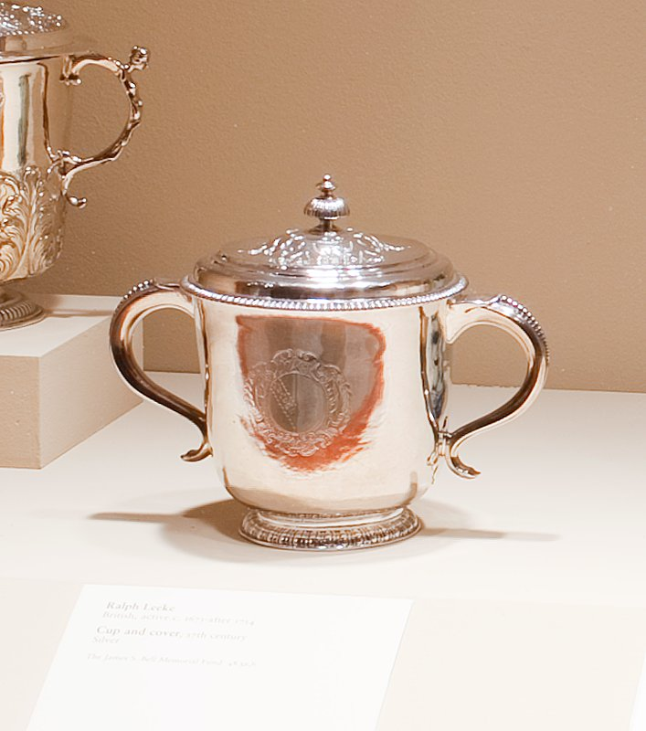 the decoration is simple; a gadrooned band on the low moulded base; beading at the rim and on handles; gadrooned finial, and cut-card decoration of leaves on cover and under handles on body