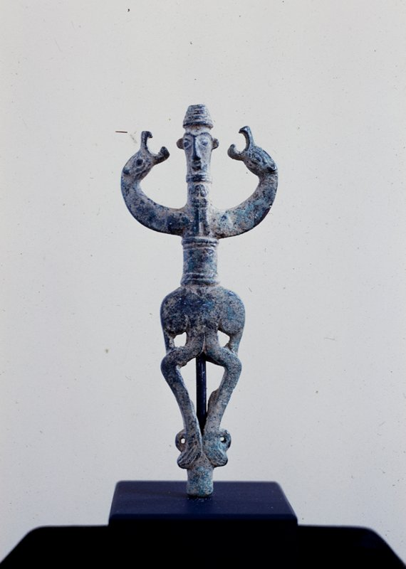 Pole top with Master of Beasts motif; bronze