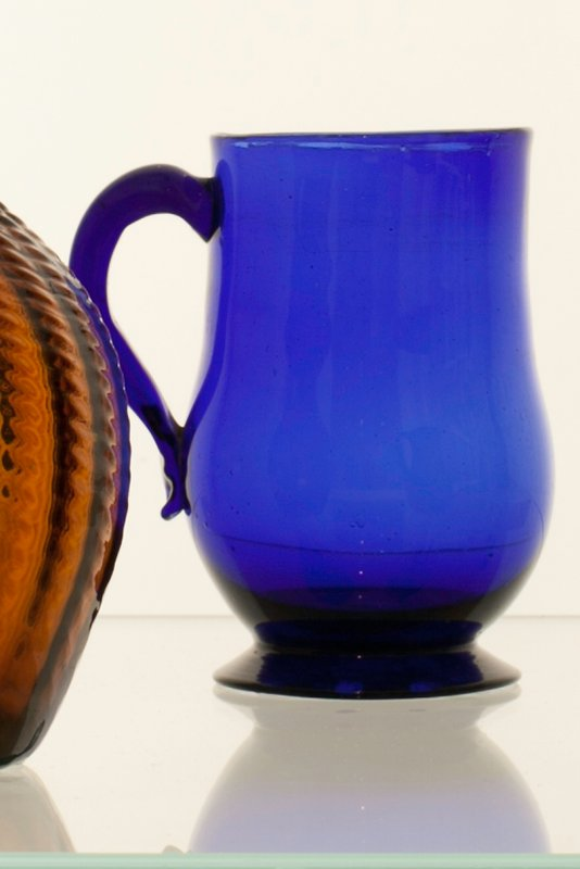 mug with handle, blue colored glass