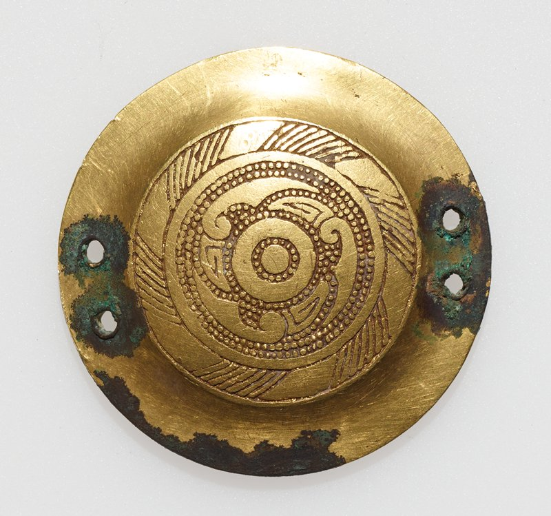 horse trapping, circular design, concentric circles with different motifs in whorls; gilded bronze, hammered or punched design.