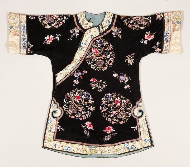 black silk, floral embroidery in shade of rose, blue and green, blue lining
